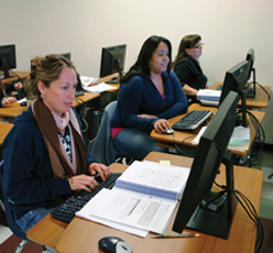 Group of students sitting at computer workstations